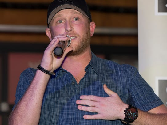 "Cole Swindell speaks at his No. 1 party for ""Flatliner"""