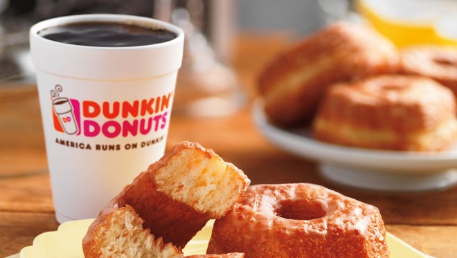 """This product image provided by Dunkin' Donuts shows the chain's new """"Croissant Donut,"""" which will be launched nationally for a limited time starting Nov. 3, 2014. It comes more than a year after the Dominique Ansel Bakery in New York City introduced its now-trademarked Cronut, which became a viral sensation and spawned numerous knockoffs.  (AP Photo/Dunkin Donuts)"""