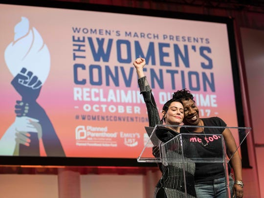 McGowan hugs Tarana Burke, right, the creator of the Me Too movement, as Burke was introduced during The Women's Convention at Cobo Center in Detroit in October 2017.