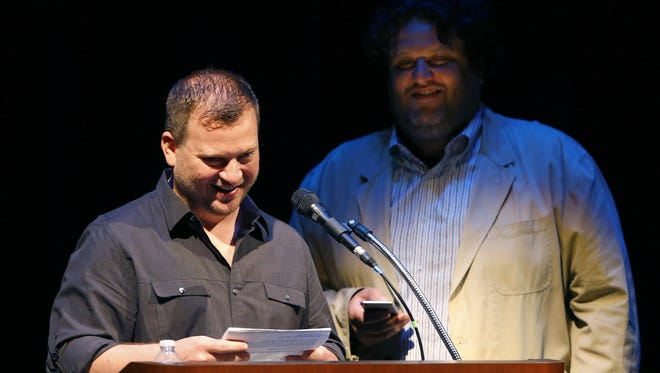 Cullen Campbell of Crudo and Aaron May of LTB Concepts read some of restaurant critic Howard Seftel's best lines during a gathering in his honor Sunday, April 26, 2015 in Phoenix, Ariz.