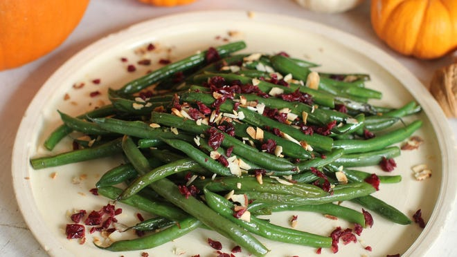 Cranberry nut green beans liven up green beans for the holidays.