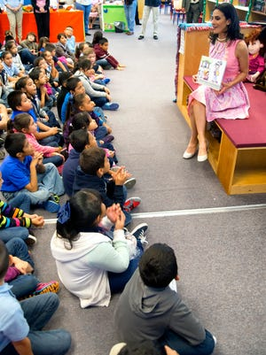 CNN correspondent Rosa Flores reads her new children's book to students at an elementary school in Texas. A new study from Nielsen explores the reading and buying habits of parents and children.