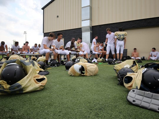 Players remove their pads for a short snack and water