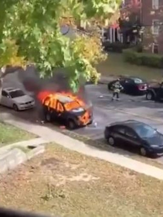 New Rochelle firefighters tame car fire.