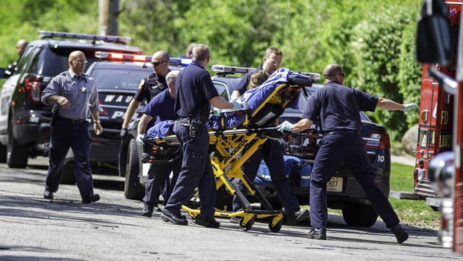 In this May 31, 2014, file photo, rescue workers take 12-year-old stabbing victim Payton Leutner to an ambulance in Waukesha, Wis. The two 13-year-old Wisconsin girls accused of stabbing her are being tried as adults.