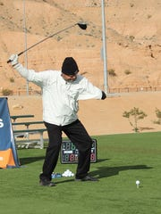 A one-armed ParaLong Drive athlete drives a golf ball.