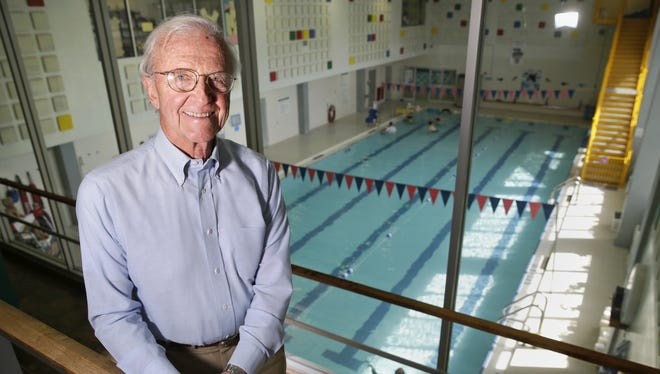 Tom Prosser, recipient of the Walter L. Rugland Community Service Award, stands overlooking the Neenah-Menasha YMCA pool.