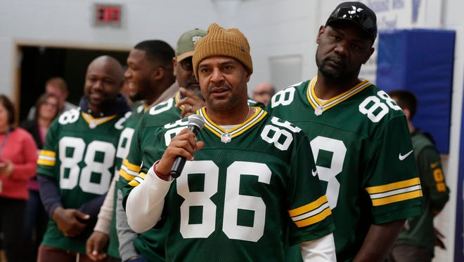 Former Green Bay Packers wide receiver Antonio Freeman answers a student's question Tuesday, April 10, 2018, during a surprise Packers Tailgate Tour stop at Oshkosh West High School. The Packers presented a $2,000 check to the school's physical education department.