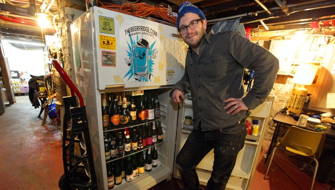 "William Seidel owns Burnhearts Bar at 2599 South Logan Ave. Thrillist named it one of the Top 31 Beer Bars in the U.S. They call this refrigerator ""Carl's Private Stash."""