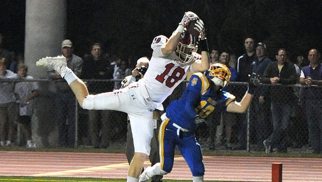 Evangel's Christian Bailiff goes up for a catch in a game  earlier this seson.