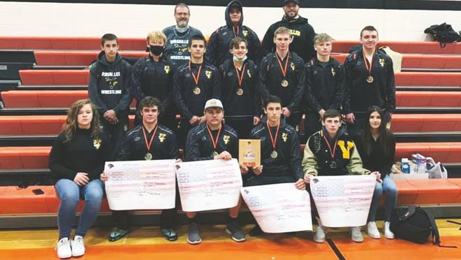 Versailles wrestlers celebrate their team title at the Ray Stockdale Invitational on Saturday, December 5, in Knob Noster.
