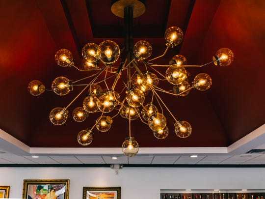 The new chandelier at Bacco Ristorante in Southfield, fabricated by artist Alex Porbe of Incite Design in Detroit, is a replica of one from the 1940s or '50s.
