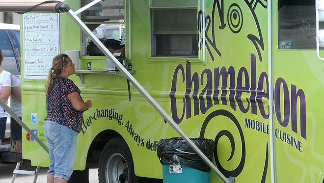 Lana Tank orders food from the Chameleon food truck on a Friday in June 2015.