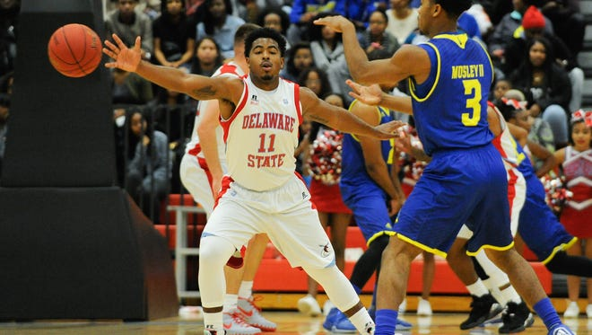 University of Delaware's #3 Anthony Mosley passes the ball in their game against Delaware State University.