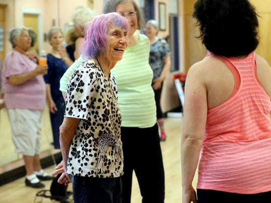 Janet Hawley-Whitmore talks with Michelle Palmer during a break in tap class as the students grab water and catch their breath between routines on Monday, Sept. 21, 2015, at the St. Claire Street Senior Center.