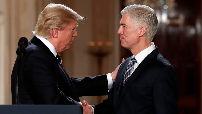 President Trump shakes hands with his Supreme Court nominee, Neil Gorsuch, in the East Room of the White House on Jan. 31, 2017.