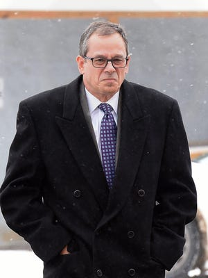Former Erie insurance executive Bradley Postema, seen in this photo from his Feb. 27 preliminary hearing in McKean, pleaded no contest on Wednesday to simple assault in a January assault on a woman he was dating and was sentenced to serve six months of probation.