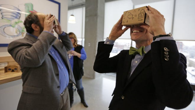 Guests at Google's Chicago headquarters check out Google cardboard virtual reality headsets.