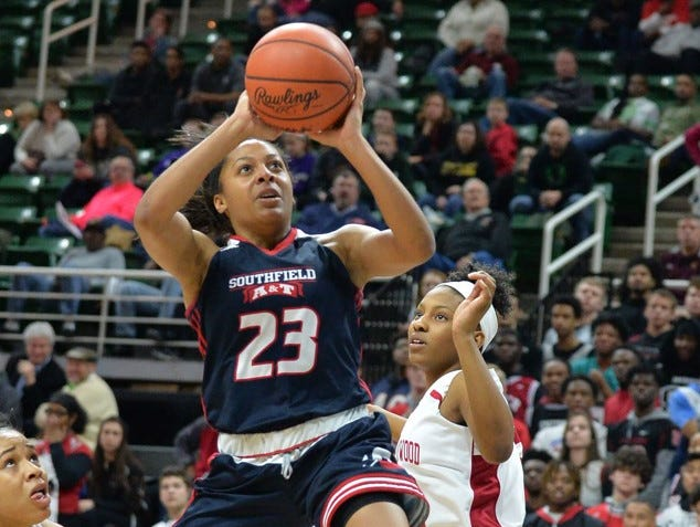 Southfield A&T senior and Michigan signee Deja Church goes up for a shot against East Kentwood in Friday's Class A semifinal at the Breslin Center. Church, a Miss Basketball finalist, had 26 points and 12 rebounds in her team's 55-51 loss.