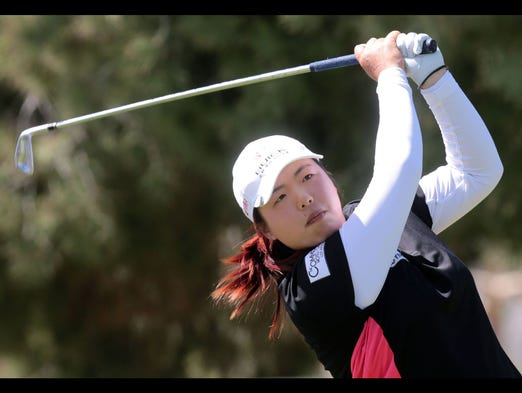 Shanshan Feng of China tees off on 17 during the first round a the 2014 Kraft Nabisco Championship on Thursday, April 3, 2014 at the Mission Hills Country Club in Rancho Mirage. Feng finished the day 6 under.