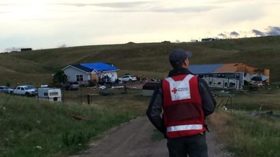 A Red Cross volunteer approaches an area of Hermosa hit by a tornado on Monday afternoon. No injuries have been reported but some homes were damaged.