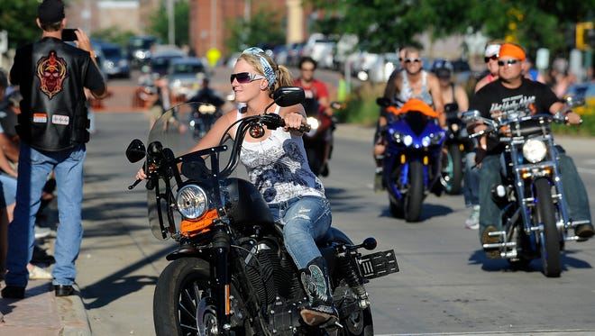 Motorcyclists take part in the Hot Harley Nights parade in downtown Sioux Falls.