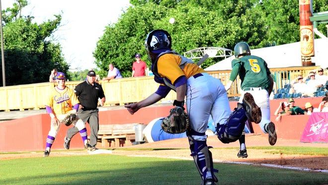 Campbell County catcher Matt Reynolds fires a quick strike to Camels first baseman Carson Plessinger to put out St. Xavier's Adam Elliott, June 18, 2016.