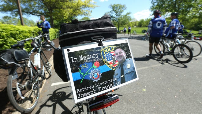 Cyclists in the Police Unity Tour take a break in Harding before passing and paying their respects near the site where retired Roxbury Lt. Joseph Franklin was involved in a fatal cycling accident during the Police Unity Tour last year. May 9, 2017, Harding, NJ