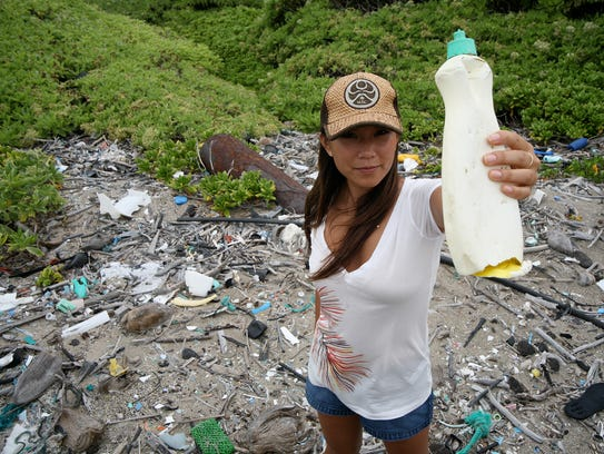 Angela Sun holds a plastic bottle in a scene from the