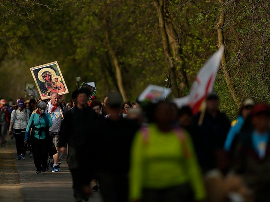 People take part in the fourth annual Walk to Mary along the Fox River Trail in Allouez on Saturday morning, May 7, 2016. More than 1,000 people took part in the 21-mile pilgrimage to The Shrine of Our Lady of Good Help in Champion.