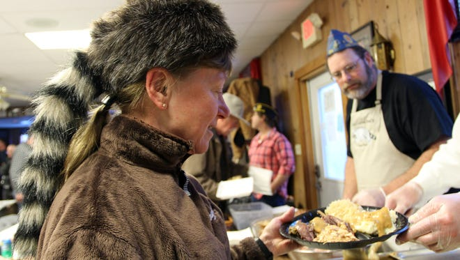 Coon Feed diner Tiger Krawczyk dons a fitting hat while supporting her veterans at a past edition of the Tom McNulty Memorial Coon Feed.