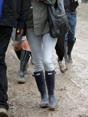 Kate Moss is one celebrity that is often seen out in public wearing Hunter Boots. Here she is attending the Glastonbury Festival in 2008 in Glastonbury, Somerset, England.