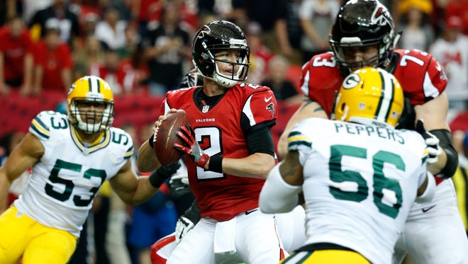 Atlanta Falcons quarterback Matt Ryan (2) looks to pass in the first quarter against the Green Bay Packers at the Georgia Dome.