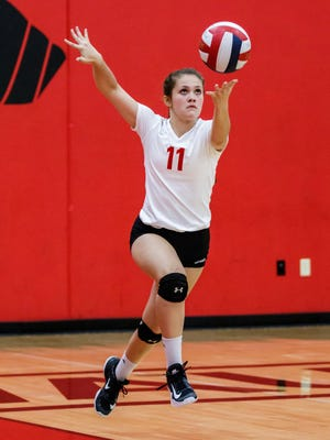 Pewaukee freshman Ally Longden (11) serves during the match at home against New Berlin Eisenhower on Tuesday, Sept. 26, 2017.