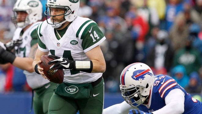 Ex-Bills defensive end Mario Williams dives to sack New York Jets QB Ryan Fitzpatrick during last years' season finale.