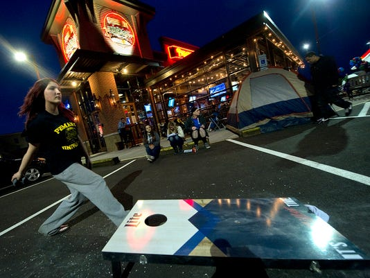 Angalea Vilella of Spring Garden Township plays bean bag toss while camping overnight for the opening of the new Primanti Bros. in York Township on Friday, May 15, 2015. In addition to waiting for the free food, Vilella was celebrating her birthday.   Jason Plotkin - Daily Record/Sunday News