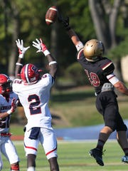 Stepinac's Atrilleon Williams (2) intercepts a pass intended for Iona's Johnryan Freeman (19), which Williams ran in for a touchdown late in the game sealing the victory for Stepinac, during  football action at Iona Prep in New Rochelle Sept. 17, 2016. Stepinac won the game 42-34.