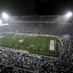 Rain dances in the portable lights at Spartan Stadium during MSU's game against Western Michigan in 2013.