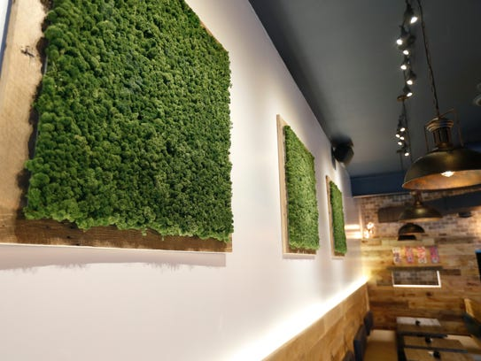 The living wall hangings made of moss help filter the air, the owner of Karai Ramen + Handroll said.