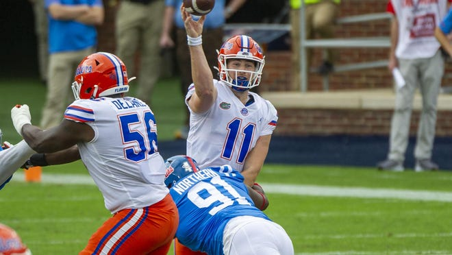 Sep 26, 2020; Oxford, Mississippi, USA; Florida Gators quarterback Kyle Trask (11) passes against Mississippi Rebels defensive tackle Hal Northern (91) during the first half at Vaught-Hemingway Stadium. Mandatory Credit: Justin Ford-USA TODAY Sports