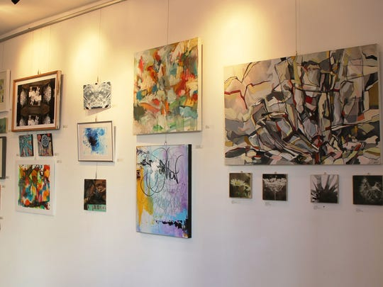 "A medley of art hangs on the wall of The Parliament Arts Organization in York for their ""Calm Chaos"" exhibit."