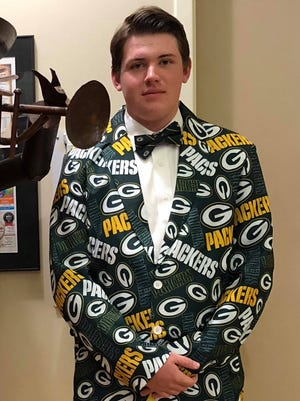 Jayson Goetz, 17, wore a Green Bay Packers suit to his junior prom Saturday, April 7, 2018, at Mosinee High School.