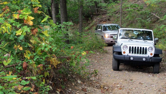 four-wheel-drive vehicles are needed now where the Old Toll Road railroad used to climb up Mount Mitchell.