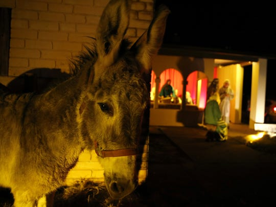 Elvis the donkey stands outside of the inn where Mary and Joseph are turned away during last year's Living Christmas Story at Killearn United Methodist Church, which runs at 6:30 p.m. through Sunday.