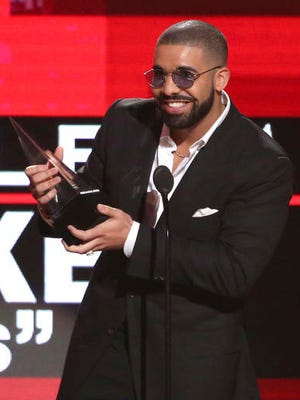 "FILE - In this Nov. 20, 2016 file photo, Drake accepts the award for favorite album rap/hip-hop for ""Views"" at the American Music Awards in Los Angeles. Drake was the most streamed act on the Spotify platform with 4.7 billion streams. The rapper has the most streamed album and song, ""Views"" (2.45 billion) and ""One Dance"" (970 million)."