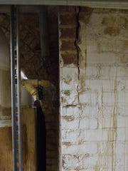 In this Feb. 2, 2017 photo, separating bricks are seen in the basement of Michigan's State House in Lansing, Mich. The Michigan Capitol's aging infrastructure is starting to wear down. The first and last major renovation and restoration project was almost 30 years ago when equipment and new systems were installed, but they have not been updated since.