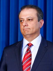 FILE- In this Sept. 17, 2015 file photo, U.S. Attorney for the Southern District of New York, Preet Bharara listens as a member of his team speaks during a news conference in New York. The outspoken Manhattan federal prosecutor known for crusading against public corruption said on Saturday, March 11, 2017, that he was fired after refusing to resign.