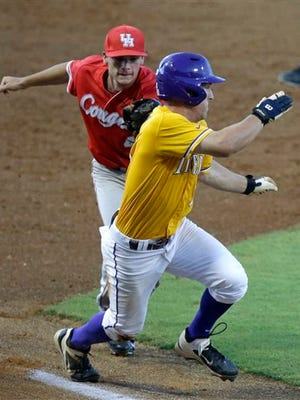 Houston infielder Connor Hollis, behind,  catches LSU's Alex Bregman  in a  rundown on a double play to end the first inning of an NCAA college baseball regional tournament game in Baton Rouge, La., Sunday, June 1, 2014. Houston won 9-5. (AP Photo/Gerald Herbert)
