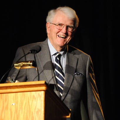 Dr. Gordon B. Snider, left, laughs as he accepts the