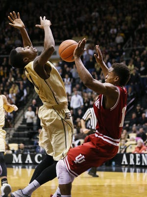Purdue Boilermakers guard Jon Octeus and Indiana Hoosiers guard Yogi Ferrell collide under the basket ending in a charging call on Octets in the second half. Purdue hosted Indiana at Mackey Arena Wednesday, January 28, 2015.